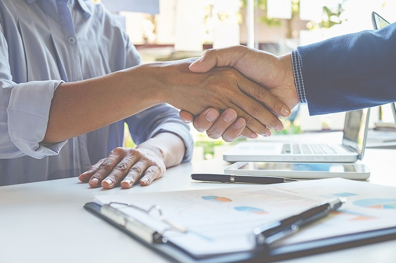 Handshake agreeing salary increase after successful negotiation