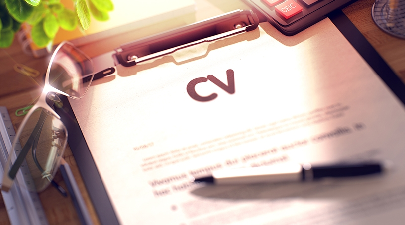 Printed copy of curriculum vitae on clipboard